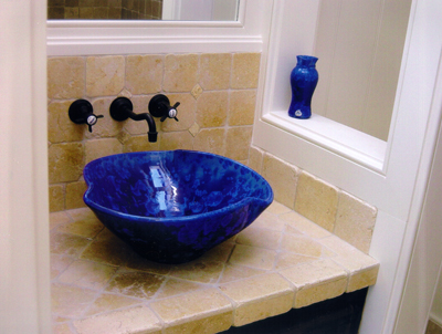 another cobalt blue vessel sink with symetrical bends installed